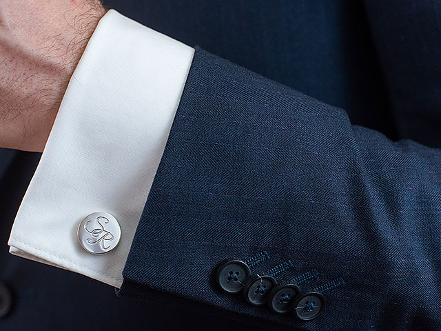 Monogram cufflinks on shirt and suit